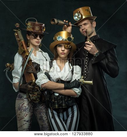 Steam punk style. The people of the Victorian era in an alternate history. Steampunk two women and a man. poster