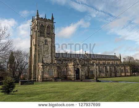Rochdale, UK - April, 28, 2016. St Chad's Church. The church dates back to the 12th Century and was extensively repaired in 1856. The church overlooks the town centre at the top of 122 steps leading to the River Roch.