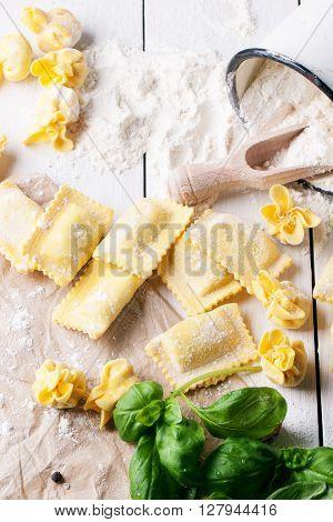 Pasta Ravioli On Flour With Basil