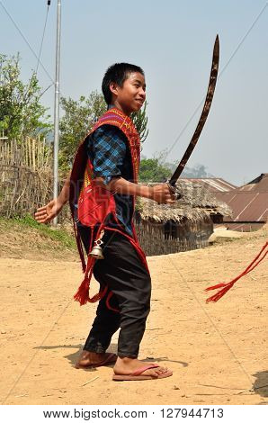 Native Boy With Sword In Nagaland, India