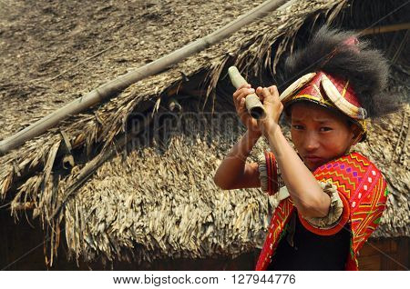 Native Boy Aiming With Stick In Nagaland, India
