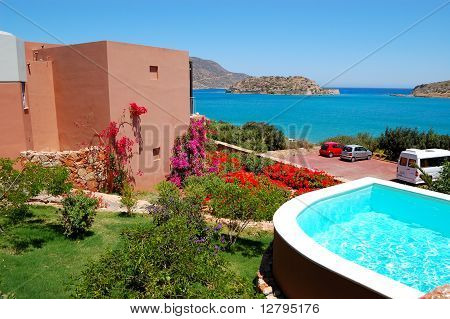 Swimming pool by luxury villa with a view on Spinalonga Island Crete Greece poster