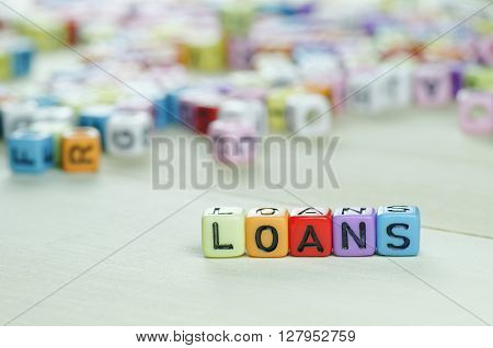 Close up of Loans word on colorful dices