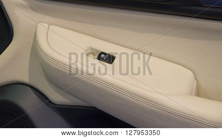 Car door interior passenger arm rest with window control panel