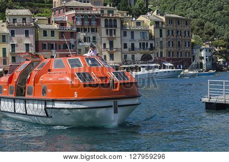 Portofino Italy - May 29 2015: helmsman moors with the ship for the transport of passengers.