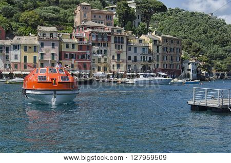 Portofino Italy - May 29 2015: helmsman docks with the ship for the transport of passengers.