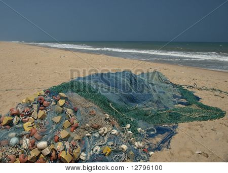 Fishing nets drying on a beach in Gana poster