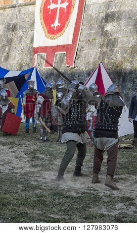 Pisa, Italy - March 26, 2016: Sword fight between knights in historical re-enactment in Pisa