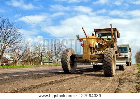 grader is working on road construction/ A close up