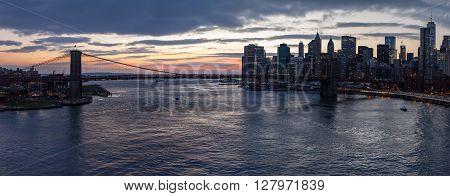 Panoramic view of Brooklyn Bridge at sunset in Manhattan New York City