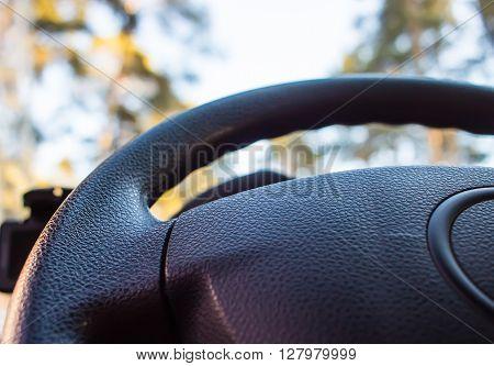 modern automobile steering wheel blur bottom view poster