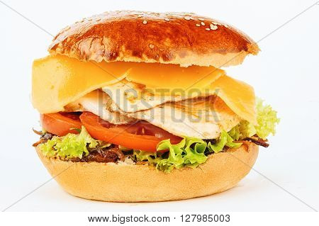 Hamburger sandwich with roasted chicken melted cheese fresh tomatoes and green salad isolated on white