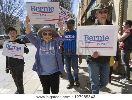 Asheville, North Carolina, USA - February 28, 2016: Enthusiastic supporters of Bernie Sanders for president march cthrough the streets carrying signs on February 28 2016 in downtown Asheville, NC
