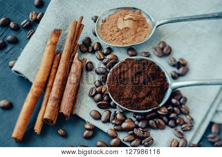 Still life with coffee cocoa and cinnamon on burlap background