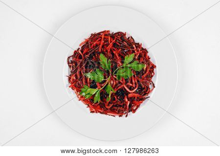 Healthy vegetarian beetroot salad with parsley isolated on white plate