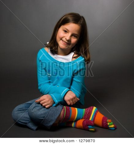 Happy Girl With Colorful Socks