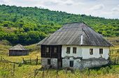 Old style stone and wood house at Pester plateau in southwest Serbia poster