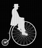 A retro penny farthing gentleman silhouette isolated on a black background poster