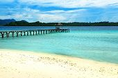 Beautiful tropical beach and wooden dock on Bolilanga Island. Togean Islands or Togian Islands in the Gulf of Tomini. Central Sulawesi. Indonesia poster