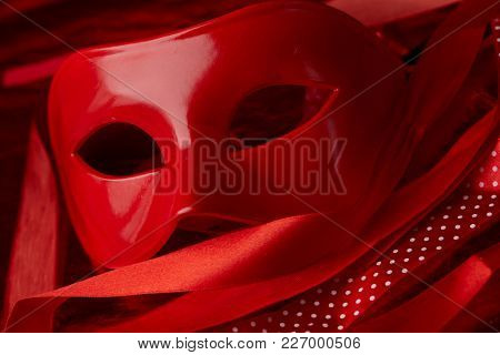 red mask and ribbons
