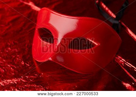 red mask with ribbons
