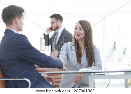 business woman shaking hands with a business partner.