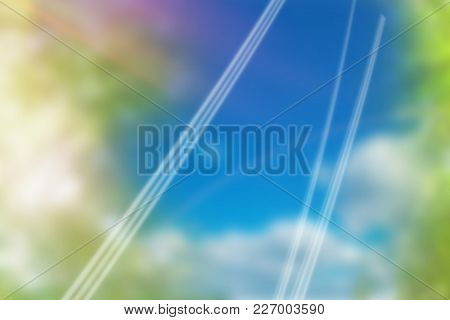 Colored background with shiny lines against green leaves