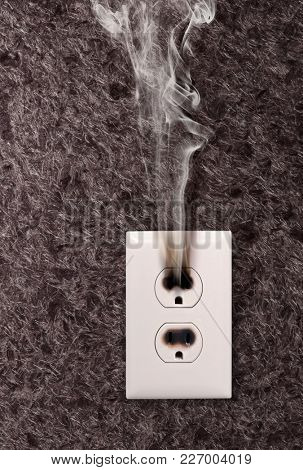 smoke from the outlet which has burned down