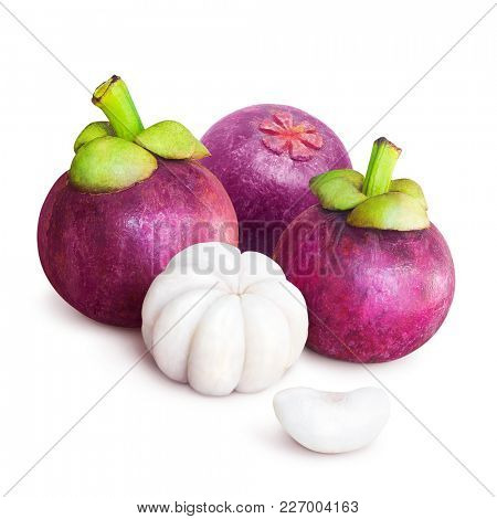 Delicious tropical mangosteen fruit isolated on white background. Tropical fruit with sweet juicy white segments of flesh inside a thick reddish-brown rind