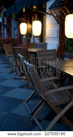 Cafe terrace with tables and chairs