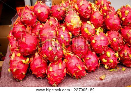 Freshly harvested pitaya (pitahaya or dragon fruit) cactus fruit on a street stall for sale at Urumchi, Xinjiang Uyghur Autonomous Region of China