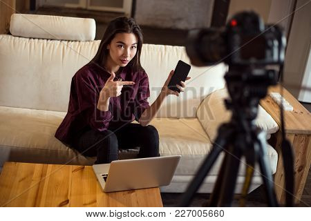 Popular Blog Stream. Attractive Young Girl Recording Video About Her Smartphone In Order To Name Pro