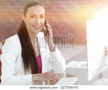 woman assistant at his workplace