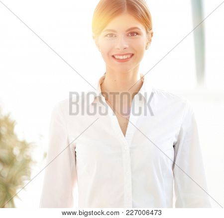 portrait of a young woman assistant in the office