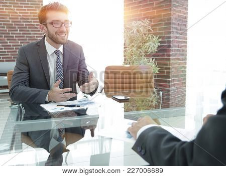 business partners are discussing a financial chart