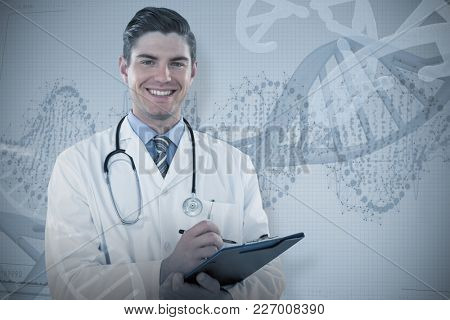 Portrait smiling doctor writing on clipboard against panoramic view of red dna pattern on screen