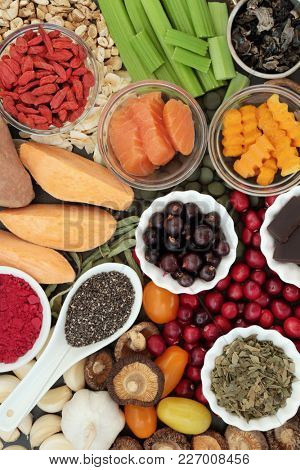 Health food concept for better brain power with fish, fruit, vegetables, seeds and herbs, super foods high in minerals, vitamins, antioxidants, anthocyanins, fibre and omega 3 fatty acids, top view.