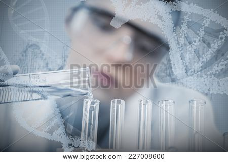 Female scientist pouring chemical against panoramic view of red dna pattern on screen