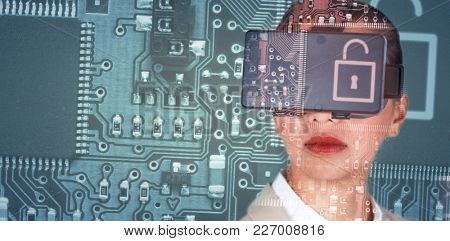 Close up of businesswoman wearing virtual video glasses against lock in circuit board