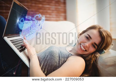 Brainstorm graphic against portrait of woman lying on couch using her laptop