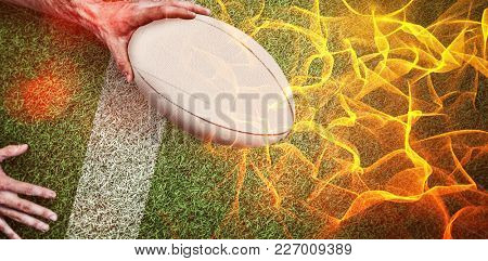 Abstract orange glowing black background against composite image of cropped image of a man holding rugby ball