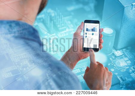 Man using mobile phone against micro parts in mother board