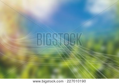Colored background with shiny lines against plants on field during sunny day