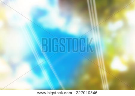 Colored background with shiny lines against autumnal leaves and sunlight