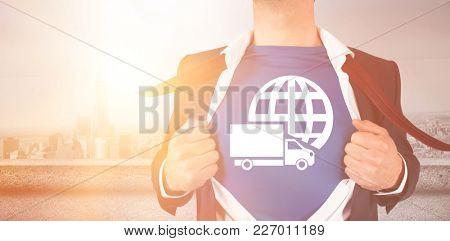 Graphic image of businessman opening shirt superhero style overlooking city