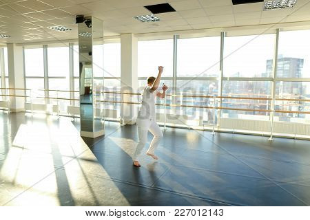 Architect Spill Out Energy In Gym, Fair-haired Guy Waving Hands Hoping. Energetic Tattooed Boy With