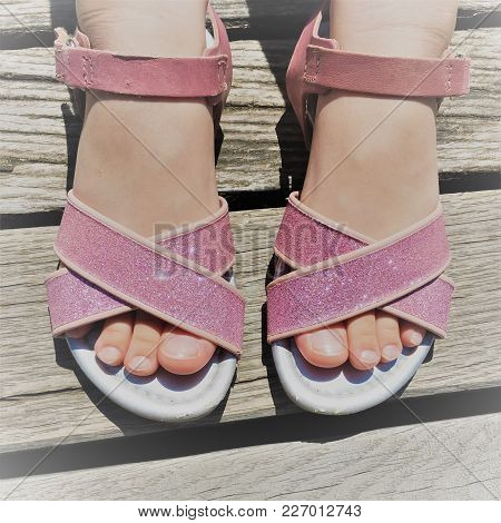 Glitter Pink Sandals On The Feet Of A Girl In The Summer