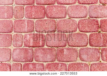 Red Pavers As A Background. Texture . Photo Of An Abstract Texture