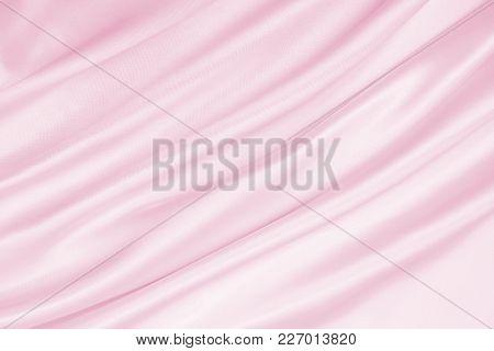 Smooth Elegant Pink Silk Or Satin Texture As Wedding Background. Luxurious Valentine Day Background