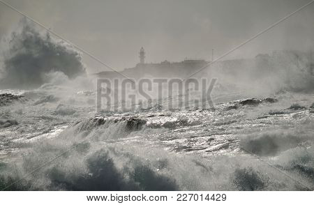 Rough Sea, Big Waves And Lighthouse In Background, Coast Of Gran Canaria